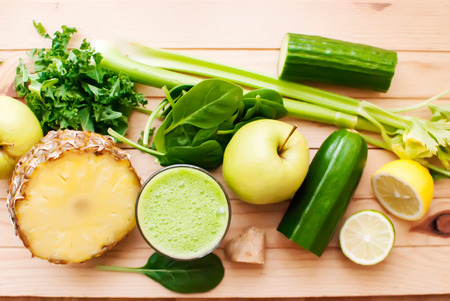 detox: healthy organic green detox juice on wood