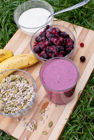 healthy berries juice smootie on wooden board photo