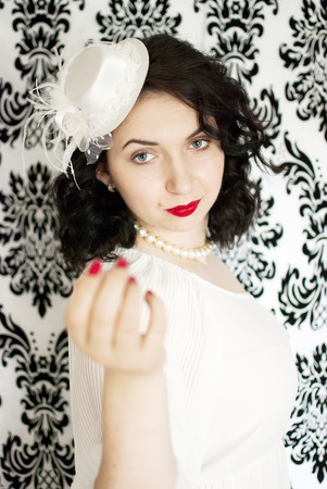 beautiful retro girl portrait in vintage style dress photo