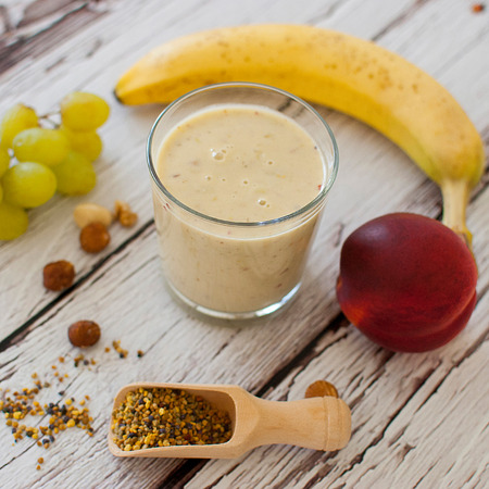 healthy organic fruit and nuts smoothie on wooden board photo