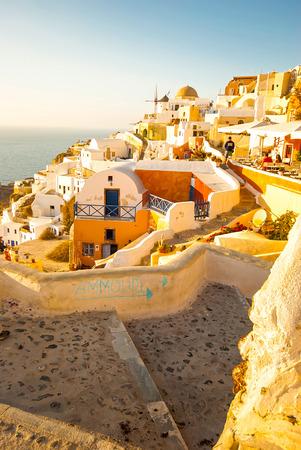 Oia Santorini Greece famous with beautiful romantic sunsets photo