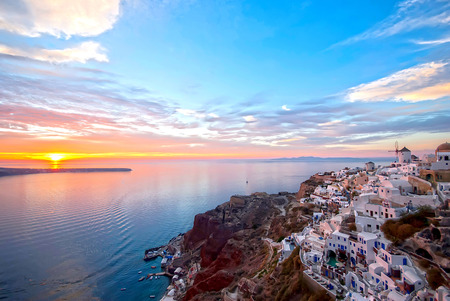 Oia Santorini Greece famous with beautiful romantic sunsets photo