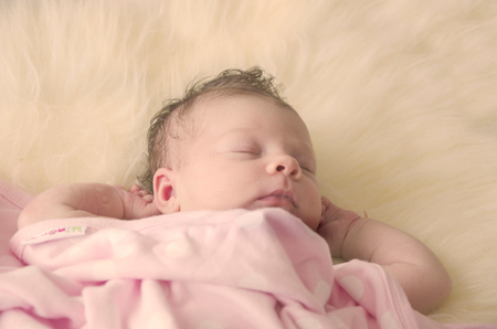 peacefully: beautiful newborn baby girl sleeping peacefully