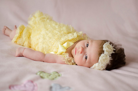 adorable two months old baby girl lying on her back on a pink blanket Stok Fotoğraf
