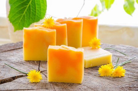 homemade orange and dandelion herbal natural soap using olive oil shea and cocoa butter