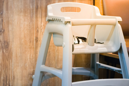 high chair seat for sit eating position for kids in fast food.use baby chair seat for safe cute child in cafe breakfast.high chair seat have guard for protect baby sitting.high chair seat position.