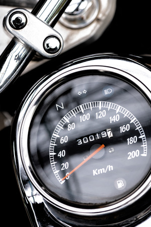 classic motorcycle mileage (dashboard , mileage) in white and black.classic motorcycle display odometer and fuel sign.