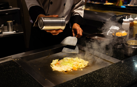 delicious japanese food with stream, professional chef cooking delicious streaming teppanyaki japanese food in restaurant