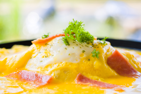 delicious fusion food from egg, delicious Omelet ham parsley and oregano on top of rice in restaurant, Omelet ham