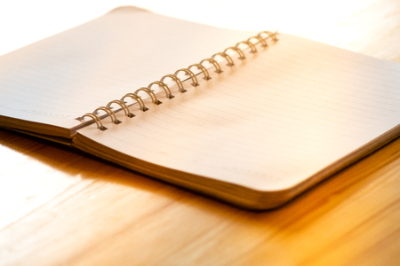 opened blank paper notebook.paper notebook on wooden desk.paper notebook on daylight at coffee shop Stock fotó
