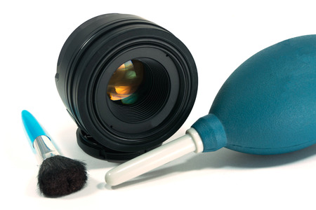 camera lens cleaning accessories on white isolated photo