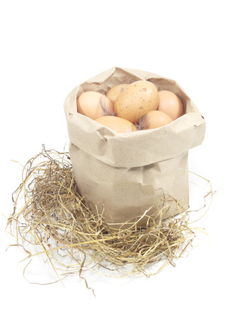 paper bag with eggs on a white background photo