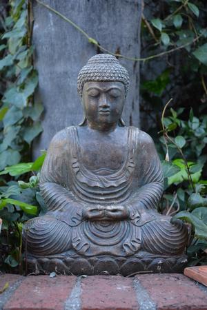 statuette: Buddha statuette in the garden Stock Photo