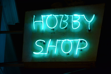 pastimes: neon sign at a craft store Stock Photo