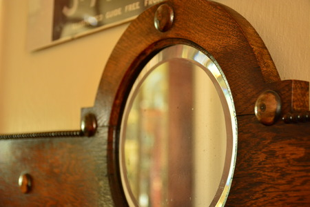 vintage furniture: mirror on an antique dresser