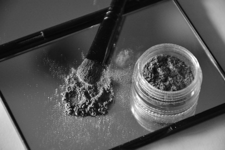 eye shadow and brush on a mirror Stok Fotoğraf