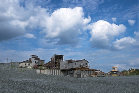 Old abandoned crushed stone production of a sunny summer day Stock Photo - 20928659