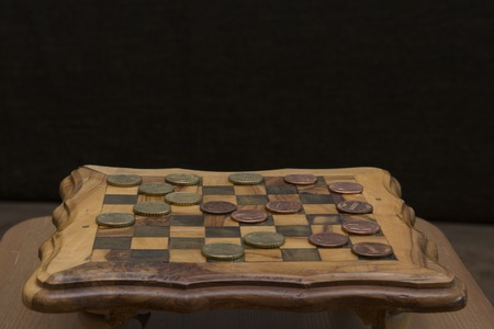 checkers: game of checkers - US cents VS euro cents