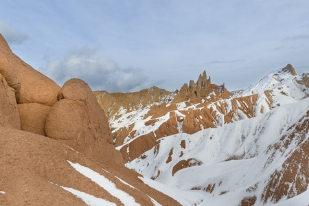Orange hills in the snow, Kyrgyzstan, witer