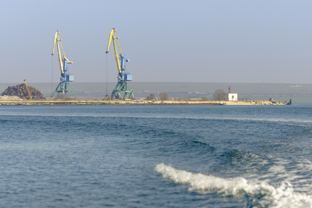 maneuvering: Two marine cranes view from the sea