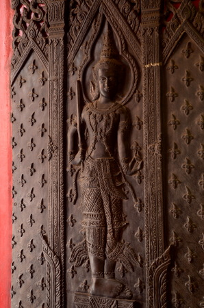 wood carving door: Thai old wood carving door Old Buddha image idol at The Marble Temple - Wat Benchamabophit, Bangkok, Thailand