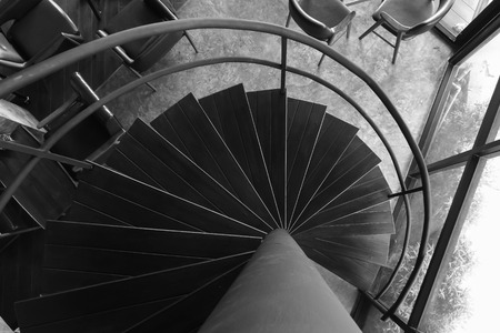 upraise: screw, wooden staircase top view in black and white