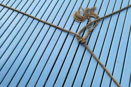 ship bow: boat rope , rope knot on wood blue Stock Photo