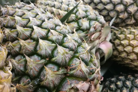 Textured skin of pineapple as a background.