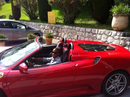 ferrari: A guy in his Ferrari car.