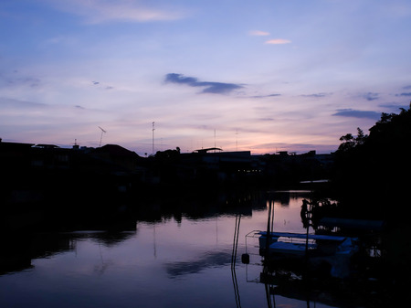 river side: Sunset at the river side with blue and purple sky scene