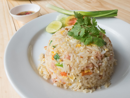 table wood: Fried rice on wood table background