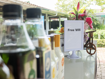 wifi: Free wifi sign with bottles foreground