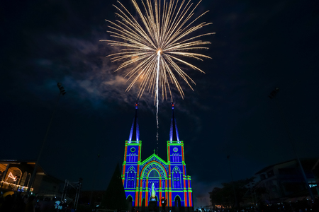 religious event: Colorful firework with virgin mary in the Christmas night