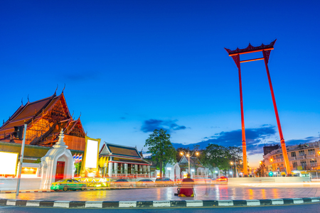 The Giant Swing (Sao Ching Cha) with long exposure light at the evening in Bangkok, Thailand.