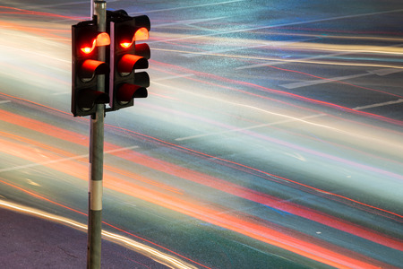 Traffic light with long exposure night in Bangkok, Thailand.
