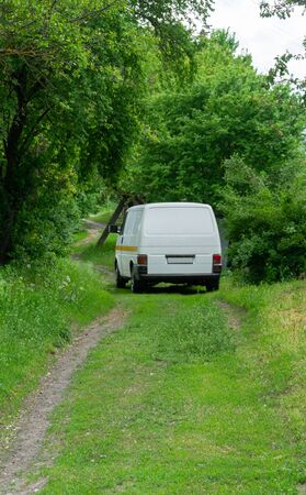 Van in the green forest, the family's vacation time.