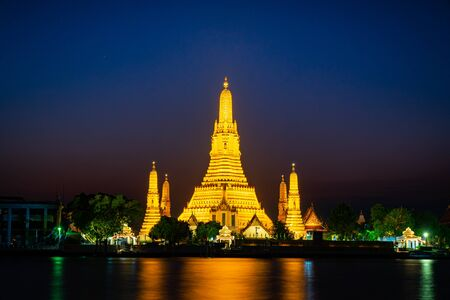 Wat Arun or Temple of Dawn at sunset. One of the most famous temple and tourists attraction in Bangkok, Thailand Stock Photo