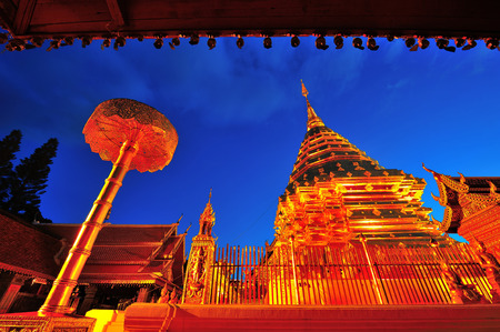 shinning light: Doi Suthep golden pagoda temple,shinning in beautiful twilight in Chiangmai,North Thailand Stock Photo
