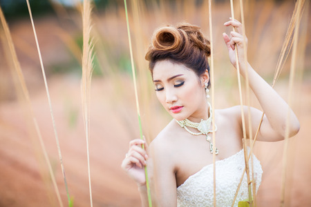 sweet grasses: portrait asian beautiful bride in forest Stock Photo