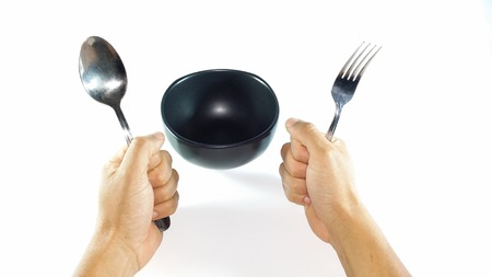 demanding: Demanding dinner empty bowl while hands are holding spoon and fork