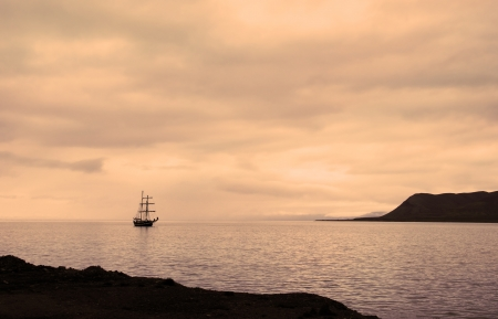 Sailing ship docked at the port of Longyearbyen