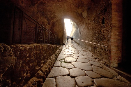 Image of a tunnel leading into the ancient ruins of Pompeii.