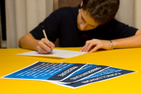 A young student busy preparing for the science fair