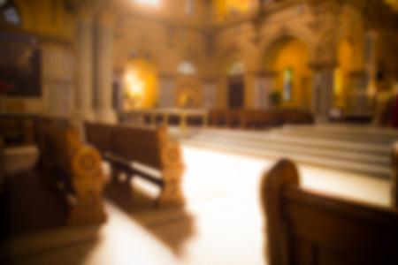 Blur style of interior of Catholic church Foto de archivo