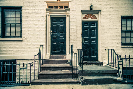 stoop: Black doors on white building.  Details of New York City architecture Stock Photo