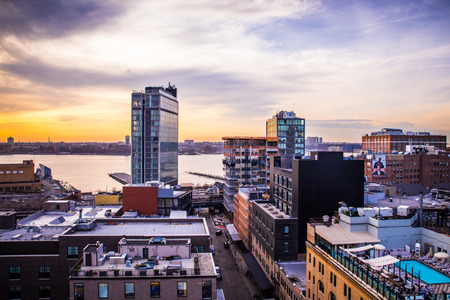 NEW YORK CITY - APRIL 6, 2015: View across Manhattan Meatpacking District and Chelsea from above, at sunset with The Standard Hotel in view.