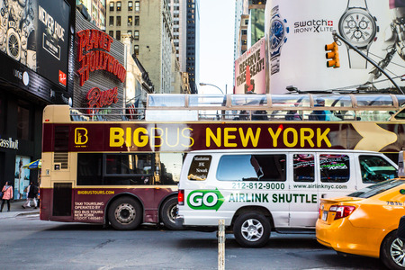 taxicab: New York City, New York, USA - March 23, 2015: Street scene with taxicab, van and tourist bus along world famous Times Square at Broadway in midtown Manhattan.