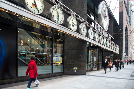 timepieces: New York City, New York, USA - March 14, 2014:  View of Tourneau Corner on posh Fifth Avenue in midtown Manhattan with pedestrians visible Editorial