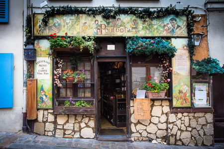 Paris, France - October 9, 2014:  View of charming French cafe in Montmartre, Paris, France. Éditoriale