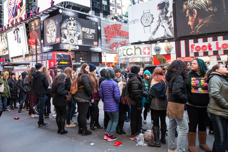 see the usa: New York City, New York, USA - March 23, 2015: Fans wait on line to see Fifth Harmony concert in Times Square midtown Manhattan.